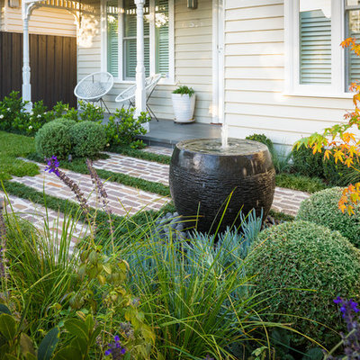 This is an example of a small front yard stone water fountain landscape in Melbourne.