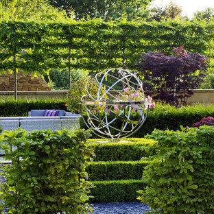 Inspiration for a traditional backyard vegetable garden landscape in London.