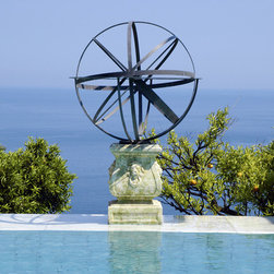 Armillary Sphere Sundial - Brass armillary sphere sundial by a swimming pool in the South of France