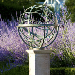 Armillary Sundial - Verdigris bronze armillary sphere sundial amongst lavender in traditional English garden