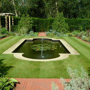 Inspiration for a traditional garden in West Midlands with a water feature and brick paving.