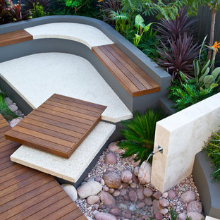 Photo of a small contemporary full sun backyard water fountain landscape in Perth with decking.