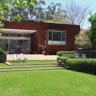 Photo of a mid-sized contemporary backyard garden in Sydney with natural stone pavers.