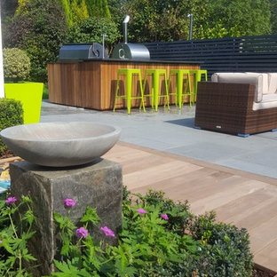 Design ideas for a contemporary back garden in West Midlands with natural stone paving.