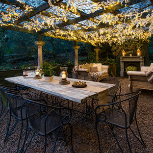 Design ideas for a mid-sized shabby-chic style backyard partial sun garden in Other with gravel.