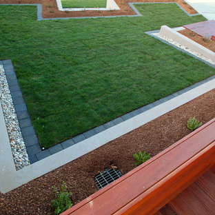 This is an example of a mid-sized modern front yard landscaping in Hobart with decking.