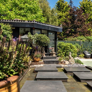 Inspiration for a world-inspired back formal full sun garden in Hertfordshire with a garden path and concrete paving.
