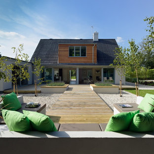 Medium sized contemporary back garden in Other with decking.