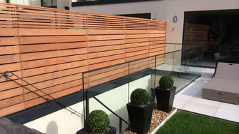 Cedar Slatted fencing with wide boards