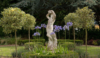 Central statue circled by holly standards and agapanthus