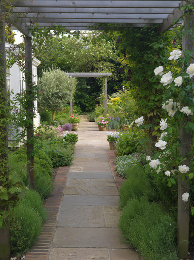 Traditional Garden by CGD Landscape Design