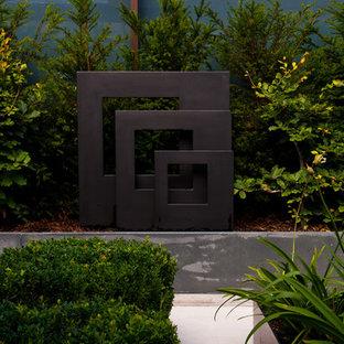 Idee per un piccolo giardino formale design esposto in pieno sole sul tetto con pavimentazioni in pietra naturale