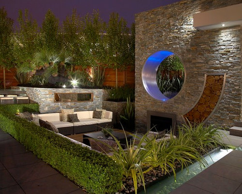 design ideas for a contemporary landscaping in london with a fire pit
