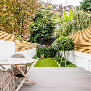 Inspiration for a small classic back formal full sun garden in London with decking.