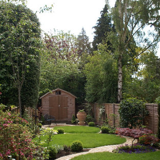 Photo of a medium sized rustic back partial sun garden in Hertfordshire with brick paving.