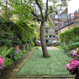 Inspiration for a classic back formal garden in London with brick paving.