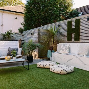 City courtyard garden with artificial grass