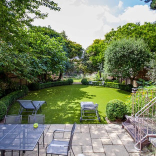 Design ideas for a contemporary backyard landscaping in London.