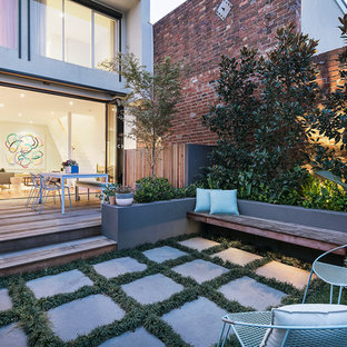 This is an example of a contemporary backyard garden in Other with concrete pavers.