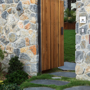 Inspiration for a mid-sized beach style partial sun front yard stone driveway in Sydney for spring.