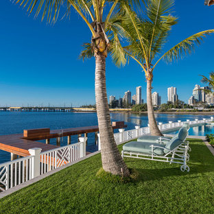 This is an example of a beach style backyard full sun garden in Gold Coast - Tweed with decking.