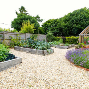 Large rural back garden for summer in Oxfordshire with gravel.