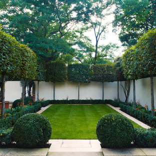Inspiration for a mid-sized contemporary shade front yard stone garden path in London.