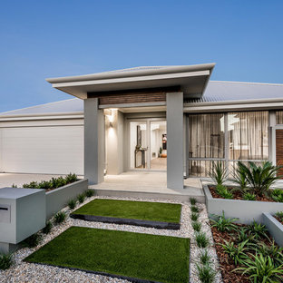 Photo of a mid-sized contemporary front yard full sun driveway in Perth with a container garden and gravel.