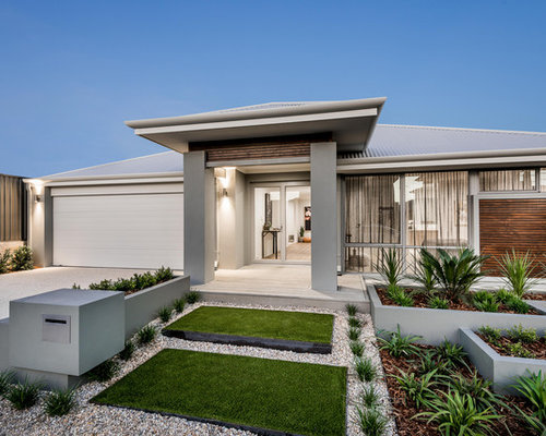 Photo Of A Mid Sized Contemporary Front Yard Full Sun Driveway In Perth  With A