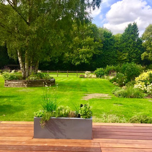 Classic back formal garden in London with a potted garden and decking.