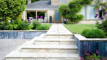 Contemporary town garden with weathered zinc walls in Bath