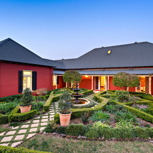 Design ideas for a country full sun formal garden in Sydney with a water feature and concrete pavers.