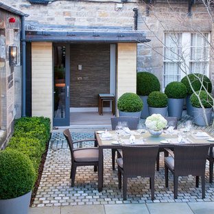 Medium sized traditional courtyard garden in Other with natural stone paving.