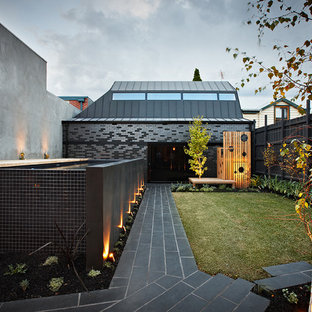 This is an example of a contemporary backyard stone landscaping in Melbourne.
