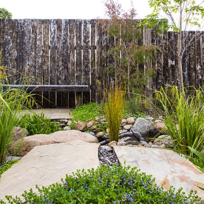 Design ideas for a small front yard stone pond in Melbourne.