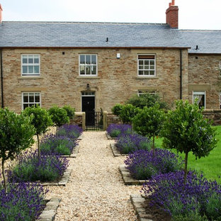 This is an example of a farmhouse full sun gravel landscaping in Other.