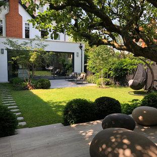 Design ideas for a medium sized modern back formal garden in London.