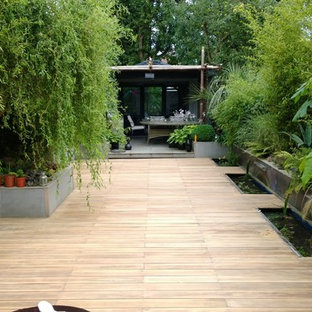 Design ideas for a medium sized world-inspired full sun garden in Berkshire with decking and a potted garden.