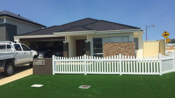 Front Yard Perfected by Synthetic Grass around/through White Picket Fence