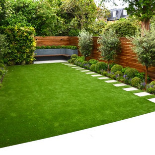 Photo of a medium sized classic back garden in London with a living wall and natural stone paving.
