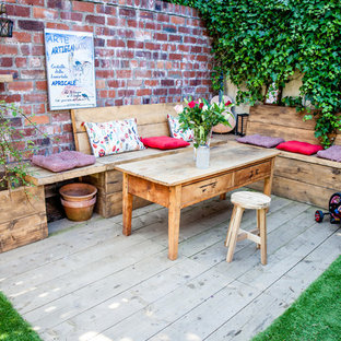Design ideas for a medium sized shabby-chic style back garden in Glasgow with decking.