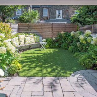 This Is An Example Of A Small Contemporary Backyard Stone Landscaping In  London.