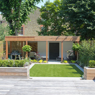 This is an example of a medium sized modern garden in London.