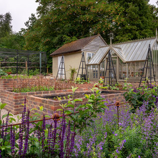 Design ideas for a classic back formal garden in Surrey with a potted garden and gravel.