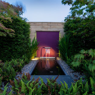 This is an example of a contemporary garden in Cheshire with a water feature.