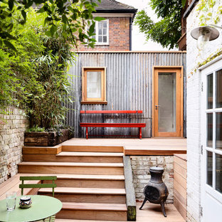 Inspiration for a medium sized contemporary back garden in London with a potted garden and decking.