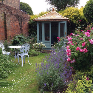 This is an example of a traditional back full sun garden for summer in Other.