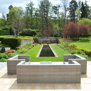 Classic formal garden in Hampshire with a pond.