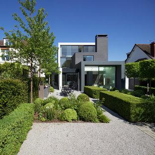 Design ideas for a contemporary back formal full sun garden in London with a garden path and gravel.