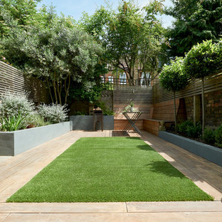 Design ideas for a contemporary back partial sun garden in London with a potted garden and gravel.